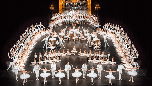 The étoiles, principal dancers, corps de ballet, and students of the Opéra national de Paris dance Harald Lander, Jacques Garnier, and Ivan Clustine